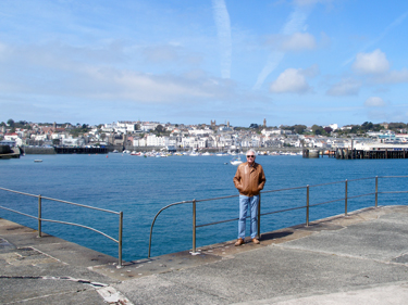 Derek on the harbour wall with the town front behind