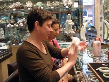 Jade trying on bracelet