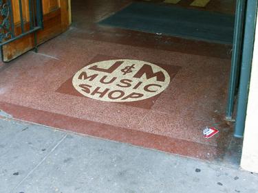 J & M Music Shop sign
