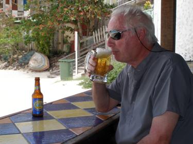 Derek enjoys a beer