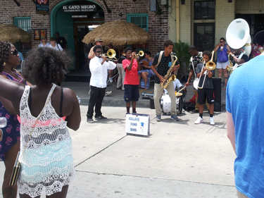 College brass band playing for donations