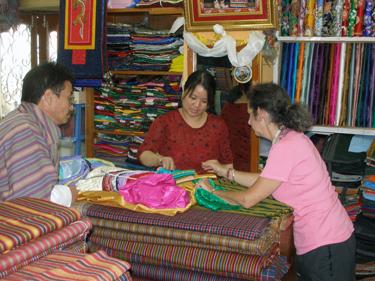 Sheila choosing blouse & material in haberdasher