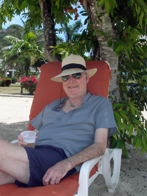 Derek enjoys a beer at the beach