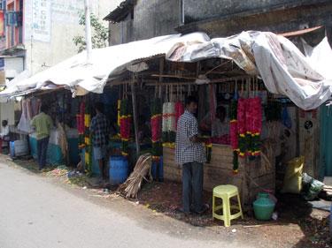 Flower garland stalls near temple