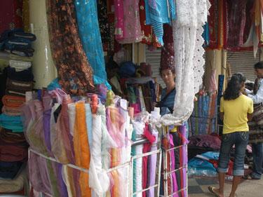 Sheila buying silk